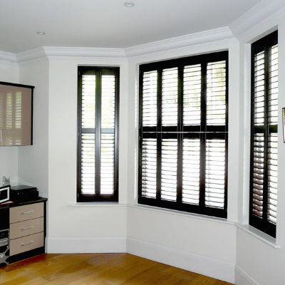 Dark wood shutters from your local shutter experts just shutters for Black window shutters interior
