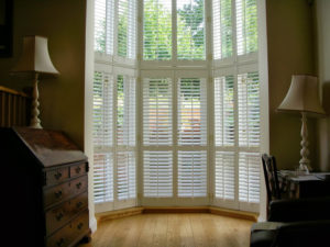 interior shutters in large window in atrium