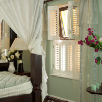 white tier on tier shutters in bedroom