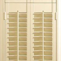 cream coloured tier on tier shutters