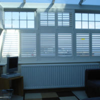 White tier on tier shutters in conservatory