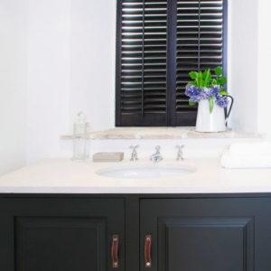 Showroom in Bebington Plantation Shutters are shown in bathroom